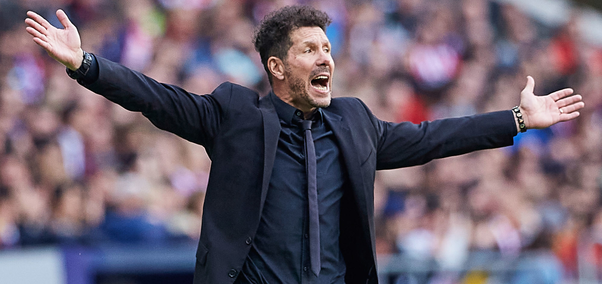 Atlético Madrid trainer Diego Simeone is gesturing during an UEFA Champions League game