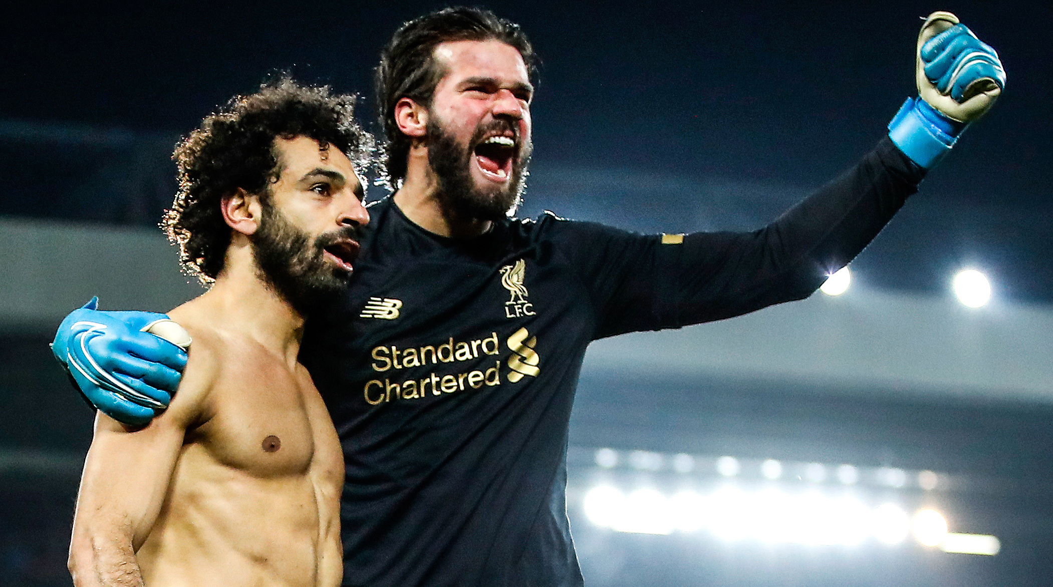 Liverpool's Alisson Becker and Mohamed Salah are celebrating after a huge goal against Manchester United
