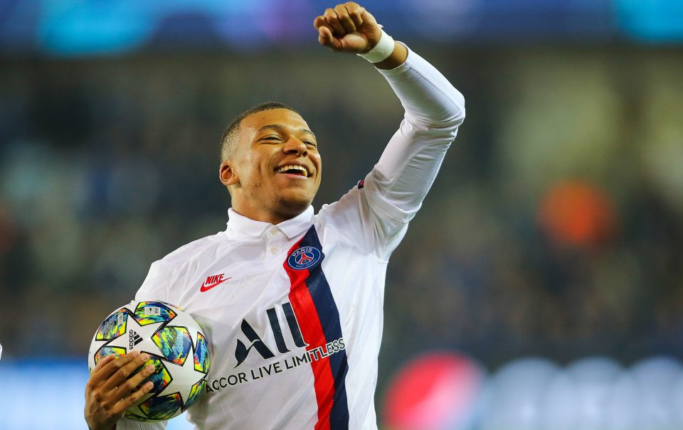 Paris Saint-Germain's Kylian Mbappé celebrates after scoring a second half hattrick against Club Brugge in the UEFA Champions League