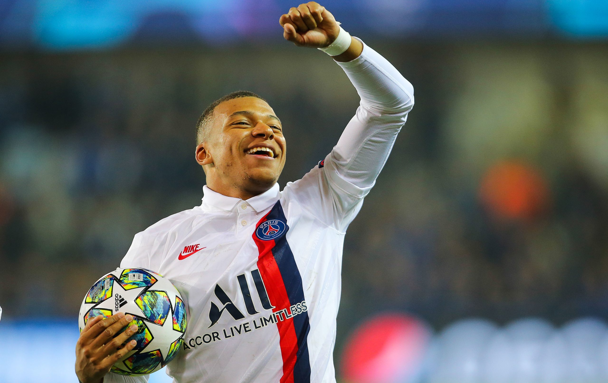 Paris Saint-Germain's Kylian Mbappé celebrates after scoring a second half hattrick against Club Brugge in the UEFA Champions League